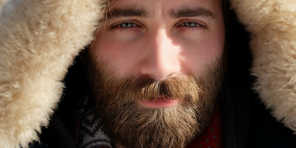 Guy with beards wearing a woolen beret