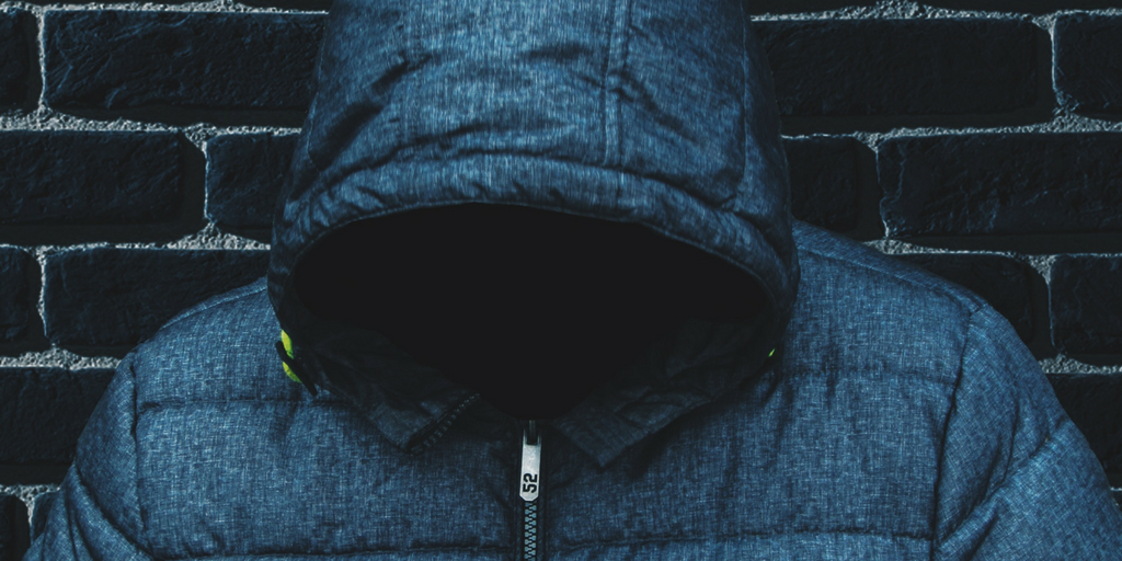 Man wearing a jacket with hidden face